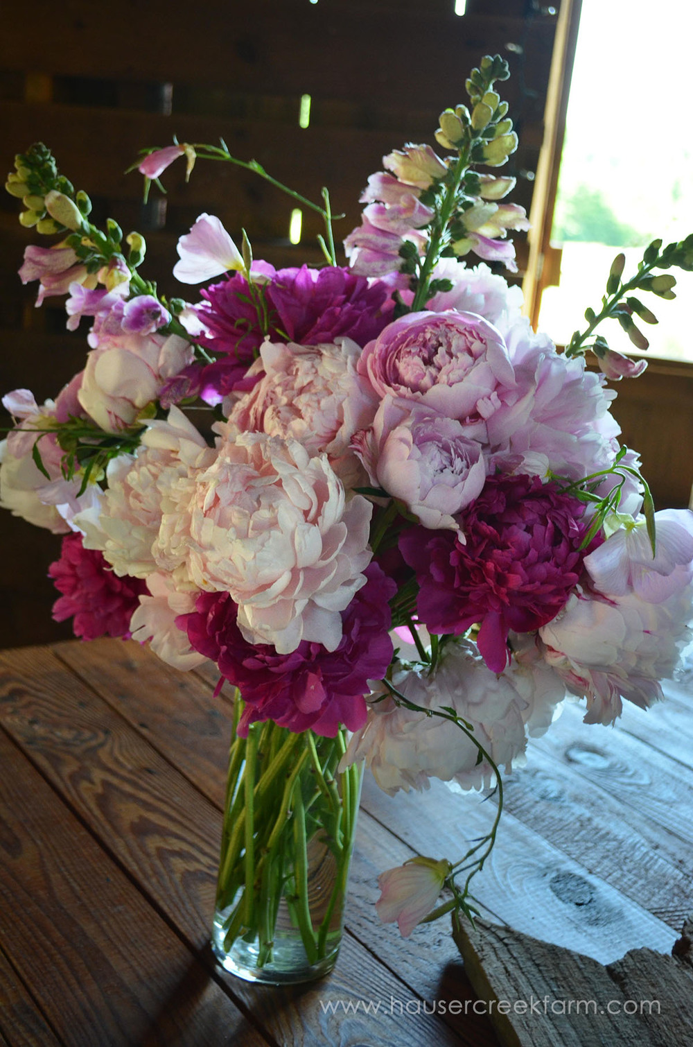 Peony arrangement on old table at the farm