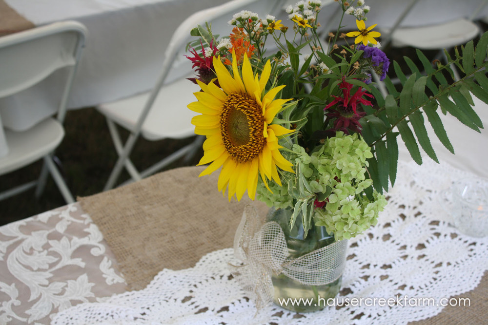 bouquet-of-wild-flowers-in-jar-for-wedding-at-hauser-creek-farm-nc-4751.jpg