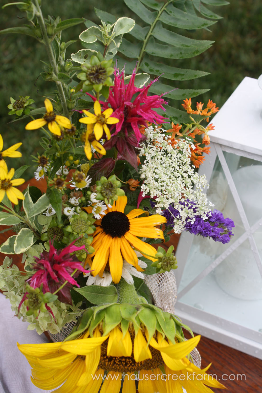 bouquet-of-wild-flowers-in-jar-for-wedding-at-hauser-creek-farm-nc-4745.jpg