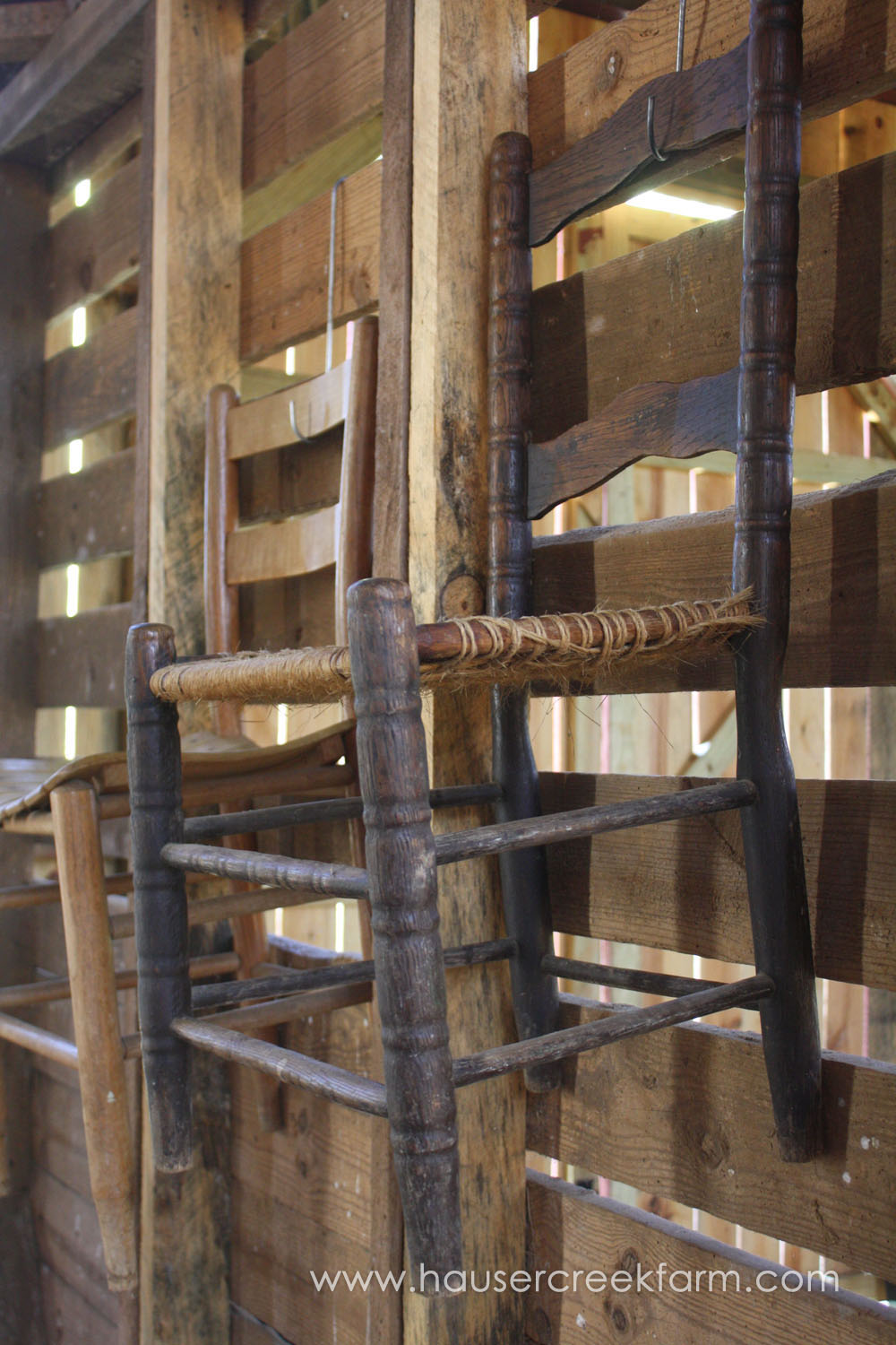 old-wooden-chairs-hanging-from-barn-wall-at-farm-in-rural-north-carolina-IMG_0593.jpg