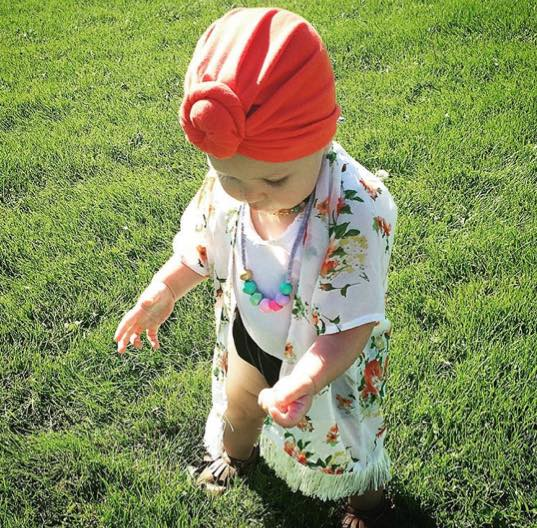 @little.miss.kaia In her  Mandy Tangerine Mini  headwear,  Coral and Cloud  necklace,  Bunny Moon Designs  kimono, and  Minimoc  Moccasins.