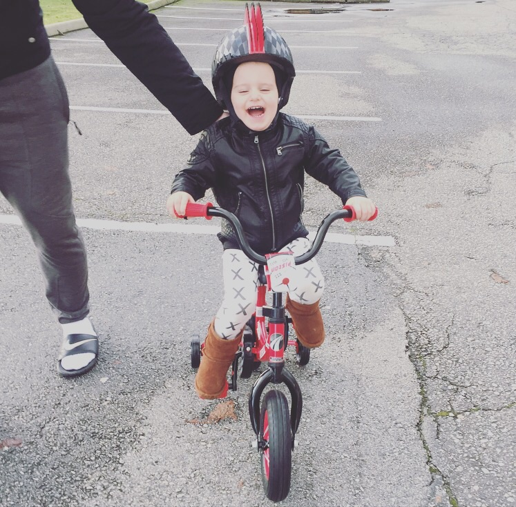 On Christmas morning, Hudson rides his first bike, which Santa left under the tree for him.