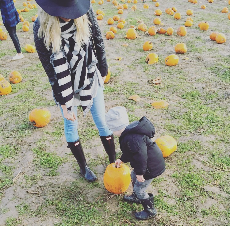 Picking out the perfect pumpkin together.