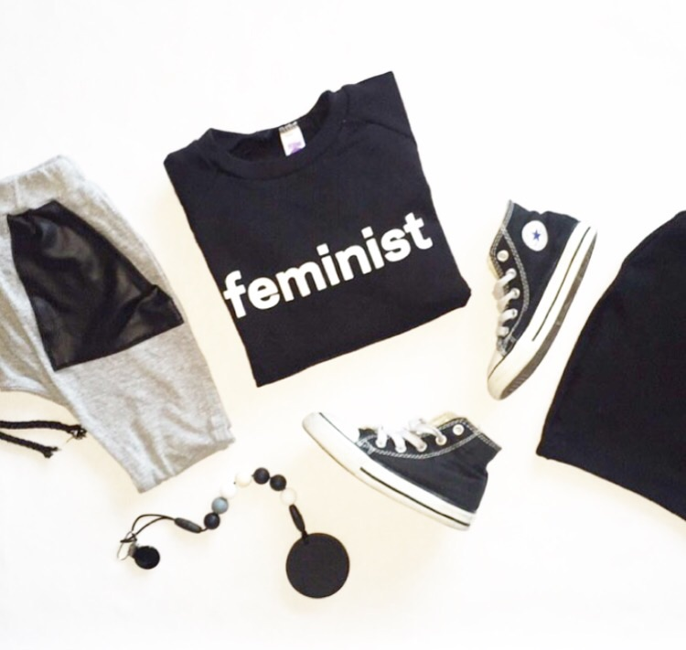"Grey harem joggers with vegan faux leather pockets and black beanie: Tiny Button Apparel | Cookie teether: Glitter and Spice | ""Feminism"" pullover: WuChild 