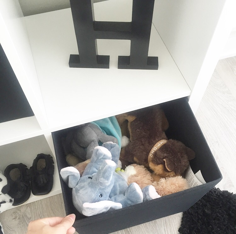 Stuffies in his IKEA storage box.