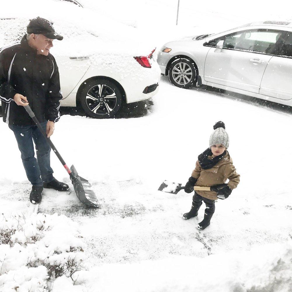 "Having fun ""helping"" Papa shovel the snow!"