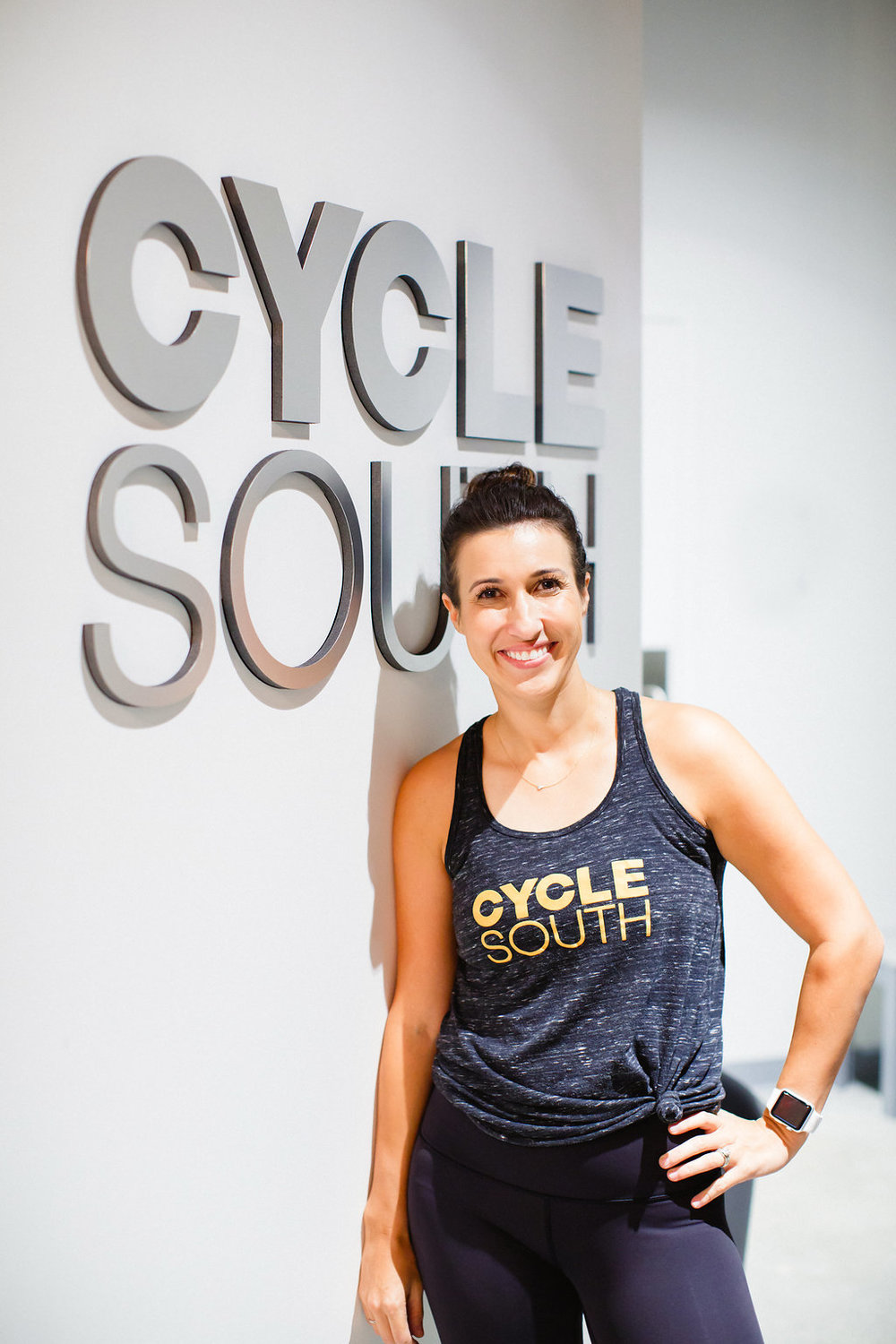 """Krystle Graham (   @krystlegraham   )   Senior Instructor   A spin class a day, will  not  keep this doctor away. That's right, this babe is doctor at CMC and mother of two and three fur-babies (re: dogs!). She is Ohio born-and-raised but has found the perfect balance right here in Queen City. One of her favorite genres? 90-2000's Hip Hop!    """"Ride. Rock. Repeat. Is there anything better?"""""""