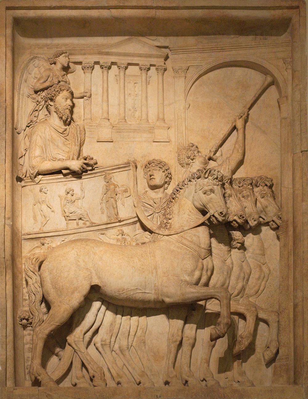 Bas_relief_from_Arch_of_Marcus_Aurelius_triumph_chariot.jpg