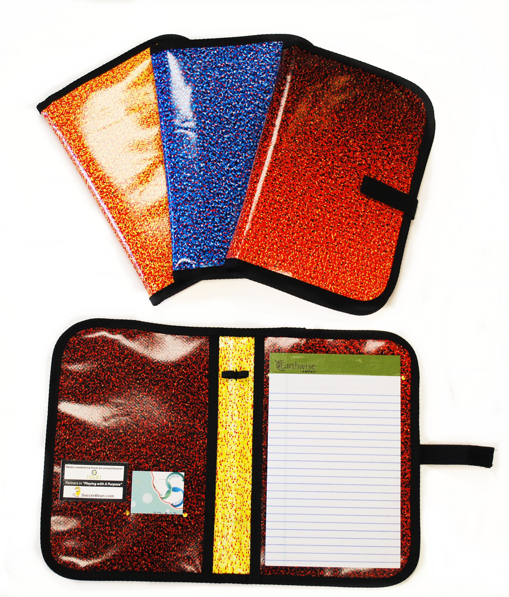 Eco-friendly, small padfolios made from repurposed materials that holds pad of paper, documents, and pen