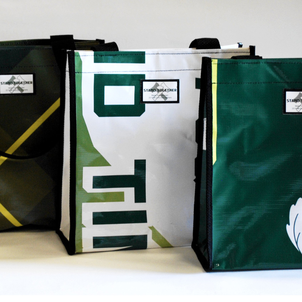 Tote bags made from repurposed Portland Timbers banners