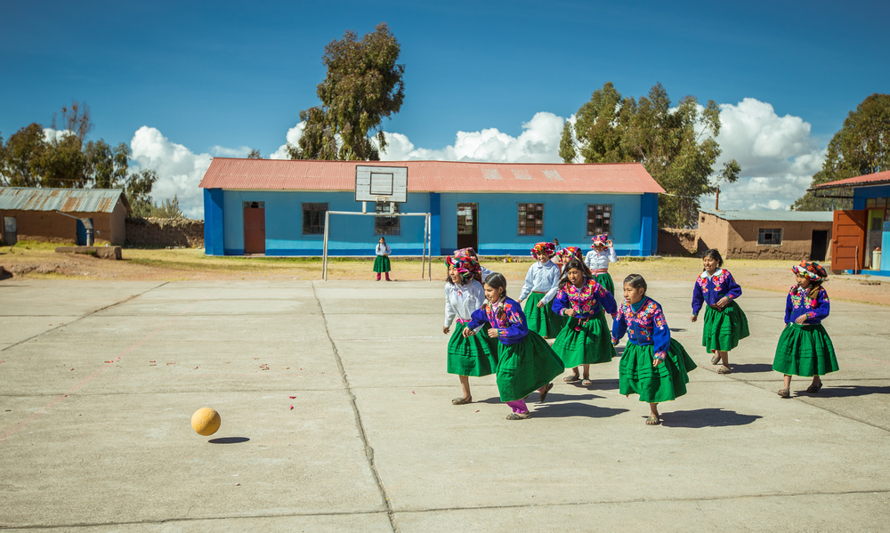 Girls playing with a One World Futbol in Peru, some of the 45 million children touched by the One World Play Project/Chevrolet partnership