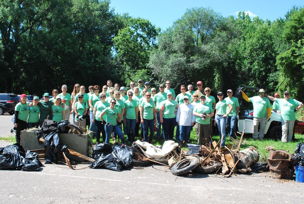 Minnesota Wild staff members participating in Adopt-a-River cleanup