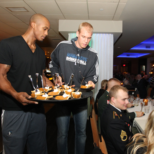 Timberwolves players serve military veterans at the Give Thanks event in Minneapolis