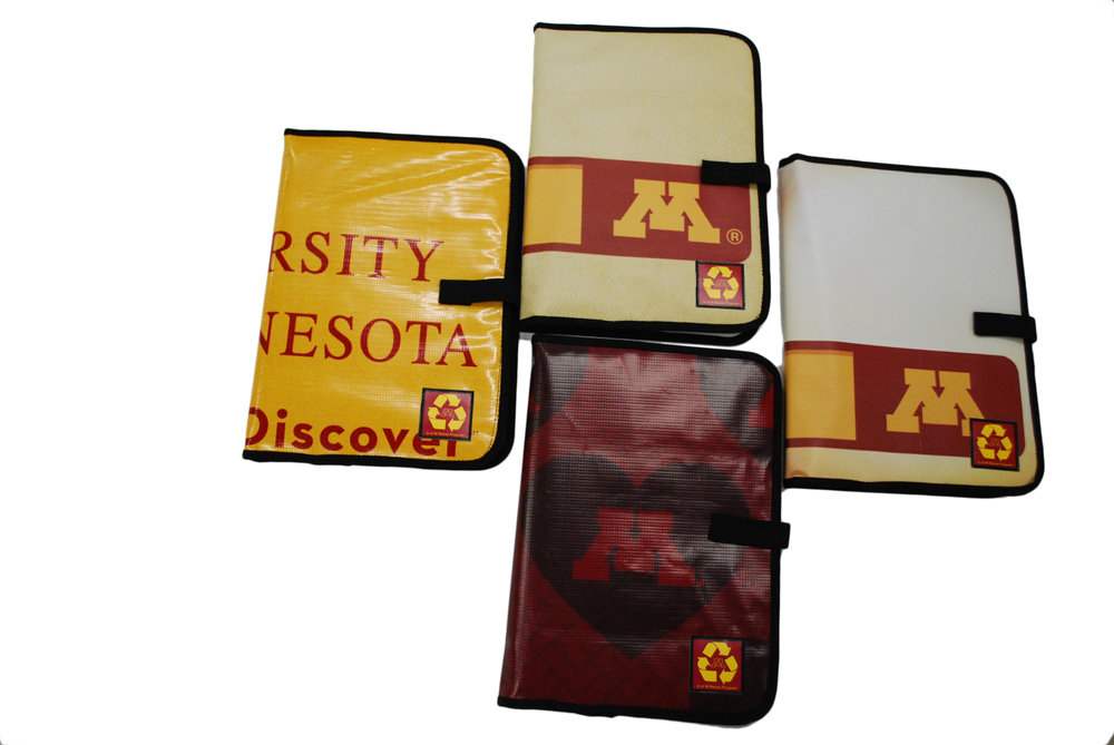 University of Minnesota padfolios made from upcycled banners and billboards