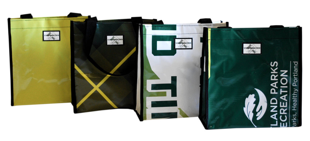 Small totes made from Portland Timbers repurposed banners and billboards