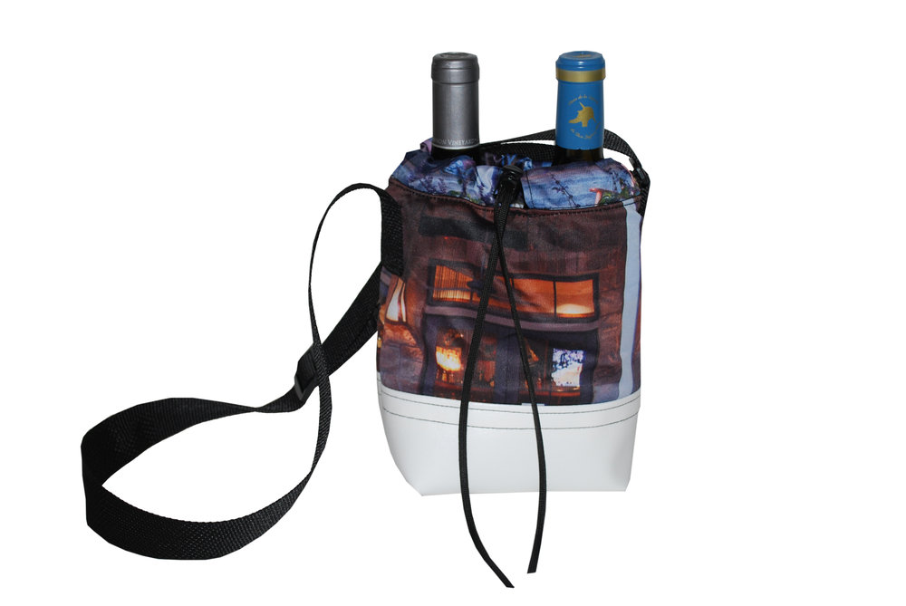 A double wine tote made from repurposed fabric, banners, and billboards.