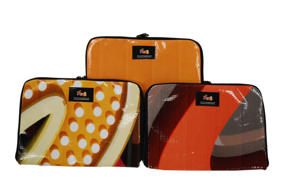 Durable tablet or laptop cases made from upcycled vinyl banners and billboards that can hold all types of tablets or laptops