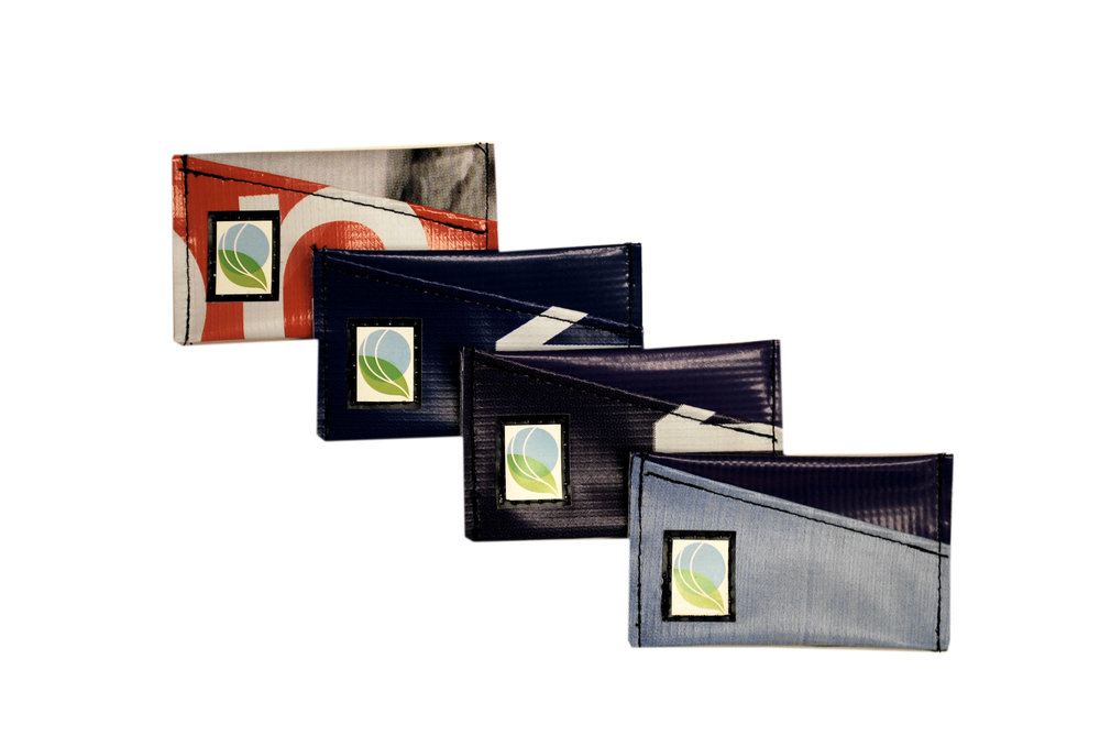Sustainable business card holders made from recycled banners and billboards