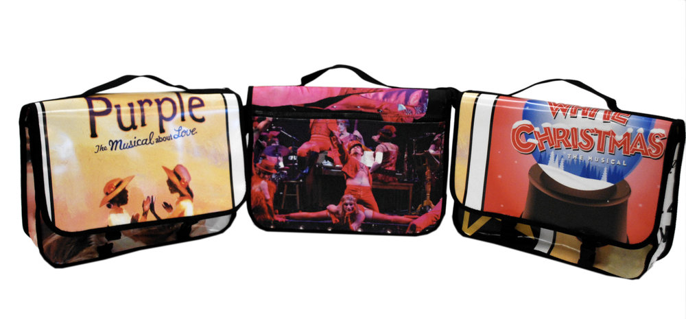 Smaller messenger bags made from repurposed banners and billboards