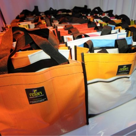 upcycled billboard bags, billboards to bags, vinyl upcycling, vinyl recycling, custom branded totes, billboard totes
