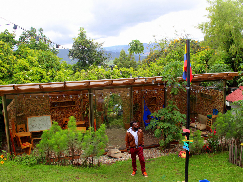 The deck sits behind the hostel and has a full bar, wood fire oven and a garden.