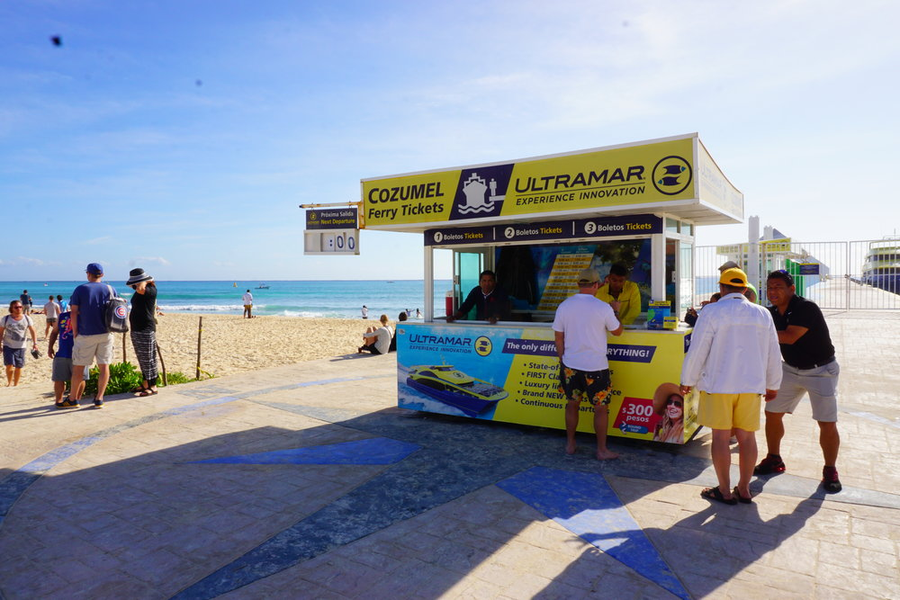 Purchase tickets to take a ferry to Cozumel on the beach at this kiosk.