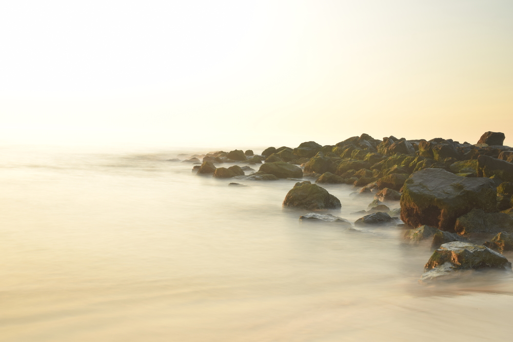 A long exposure shot providing a nice misty background and beautiful, soft exposure of the rocks in the background