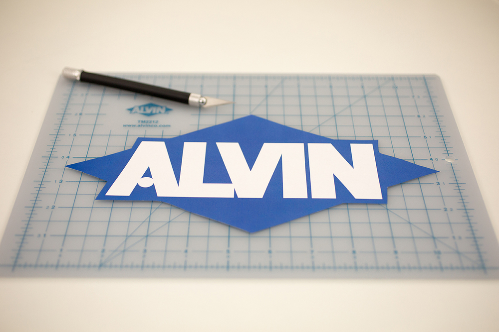 Alvin® Zippy Easy Grip No. 1 Black Barrel Knife Item No. K601 & Alvin® TM Series Translucent Professional Self-Healing Cutting Mat 8 1/2 x 12 Item No. TM2212