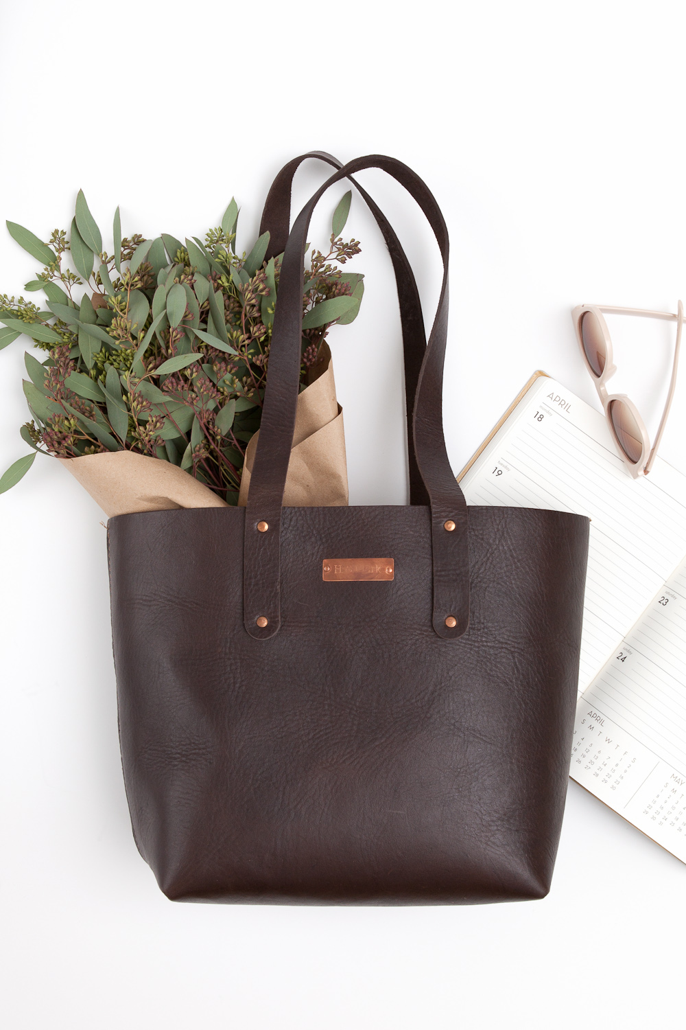 styled product chocolate leather bag