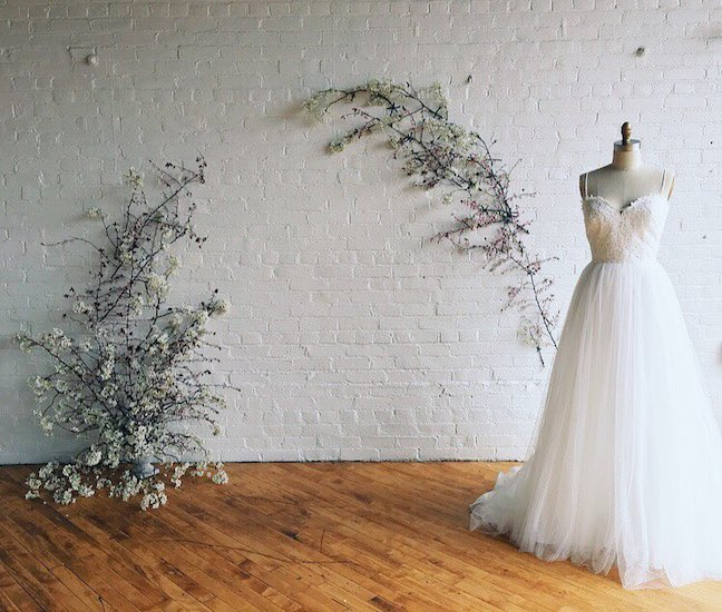 Photo by  Love Hunters  | Wall Florals by  Jamie with State + Arrow