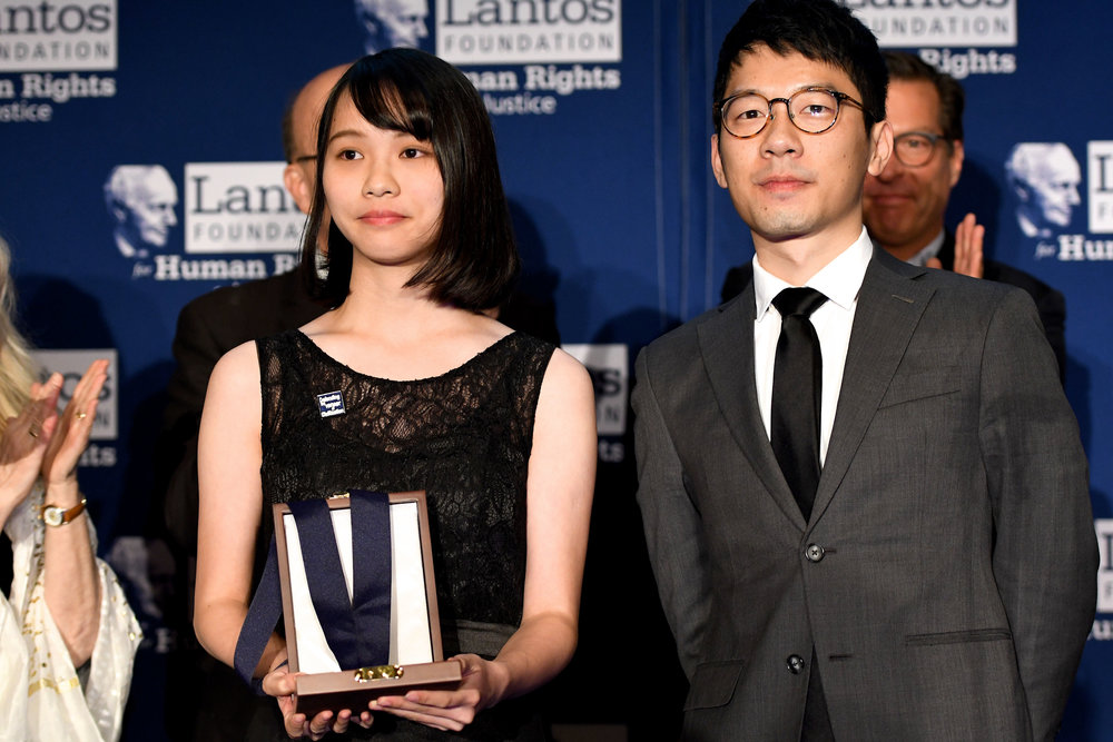 Agnes Chow and Nathan Law accept the 2018 Lantos Human Rights Prize on behalf of Joshua Wong.