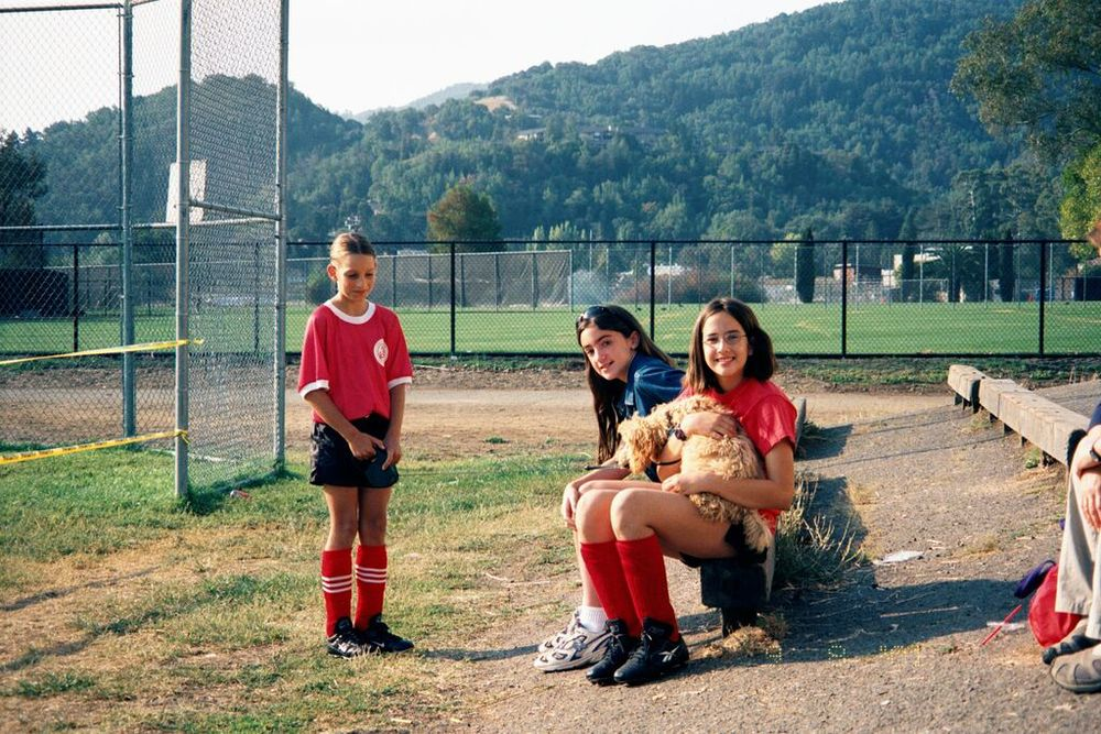 Spending time with some friends post soccer practice, circa grade 6. That's me, snuggling my dog Chloe. Note my general size (obvious even while seated) compared to my friend Gina.