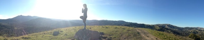 Striking tree pose while exploring the rolling hills in San Rafael, CA
