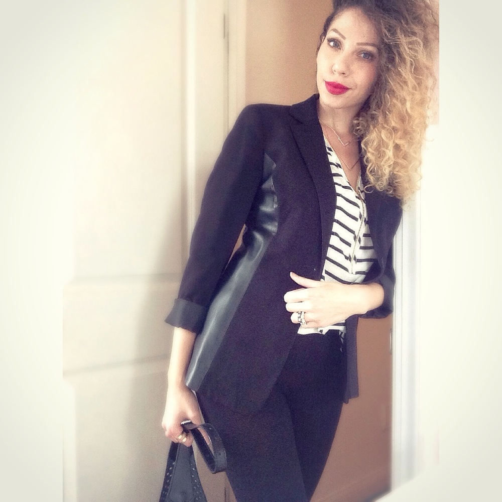 Black suit outfit, with stripes for contrast, creates a simple, but impactfulbusiness casual look
