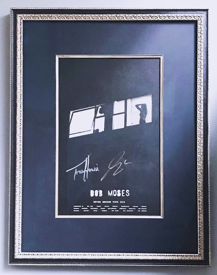 The silver reflects the grey and white tones of the piece. The line quality of the frame allows the ornate texture to be complimentary and elegant without overpowering. S igned poster from Bob Moses 2016 tour.