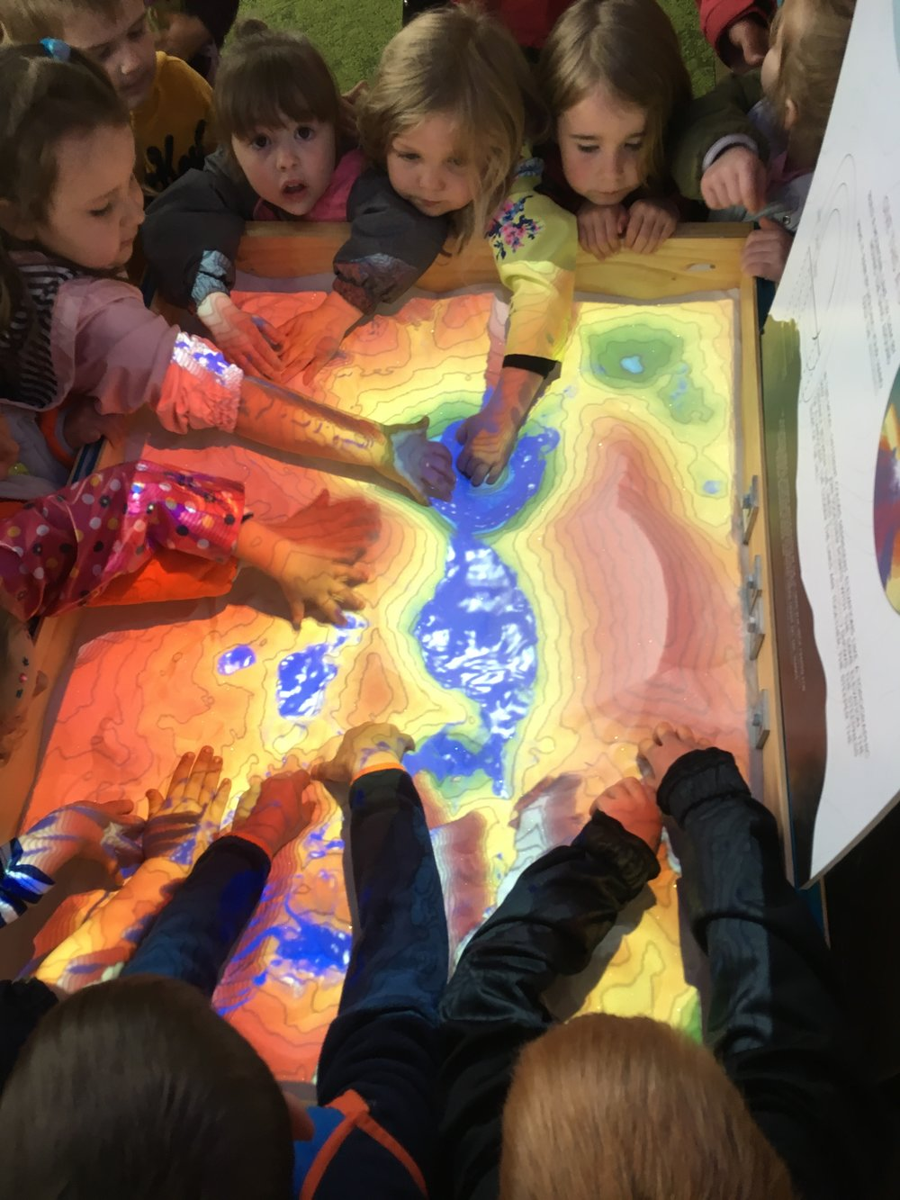 An impromptu visit from some preschoolers proved that the table is also a huge draw for Riveredge's youngest guests. They loved making it rain!