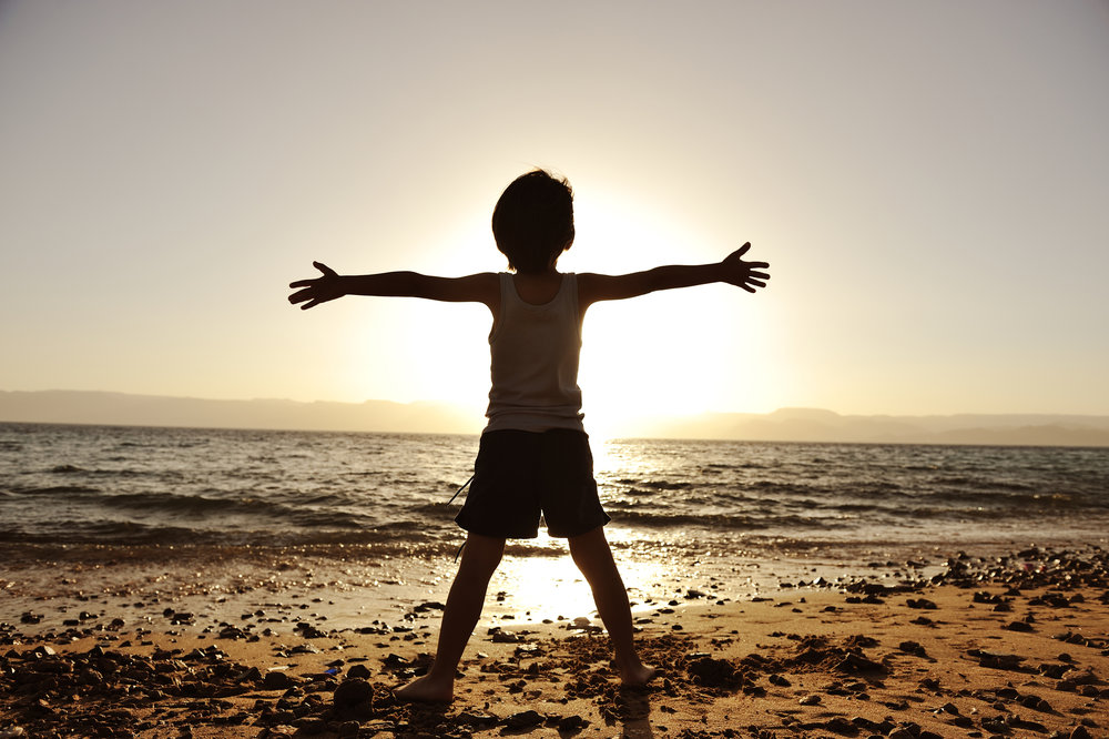 boy, beach, sunset, happy, content, arms wide open