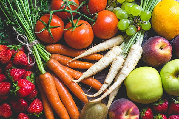 Fresh veggies and fruits piled up together