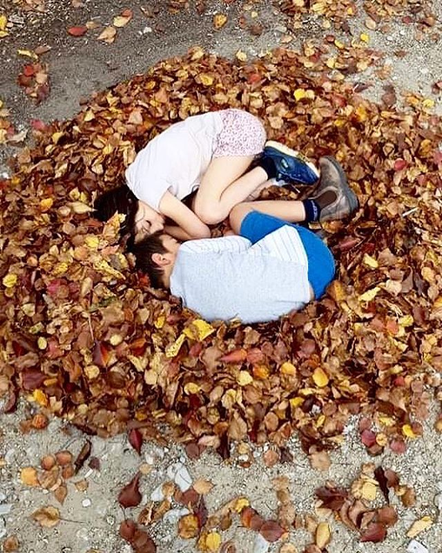 Glorious autumn days are made for making fallen leaf nests and curling up like baby birds 🍂 . . . . #countrykids #crazykids #siblings #bestfriends #childhoodunplugged