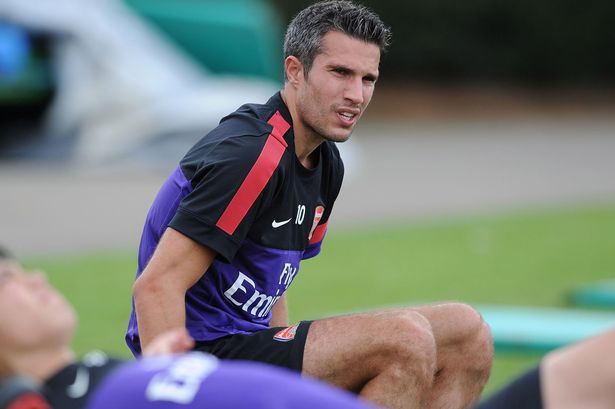 Robin van Persie of Arsenal during a training session at London Colney.jpeg