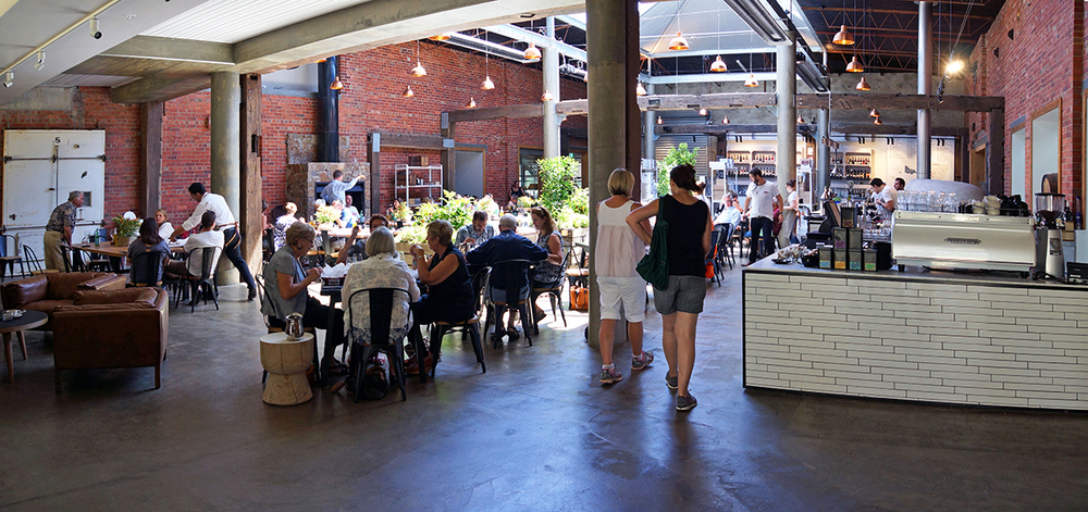 The Shed, with its spectacular atrium framed by large historic timber columns from the old Woolloomooloo wharf at The Epicurean Red Hill