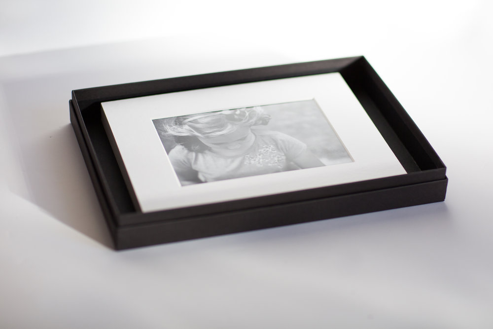Five mounted 5 x 7 Prints in a presentation box.