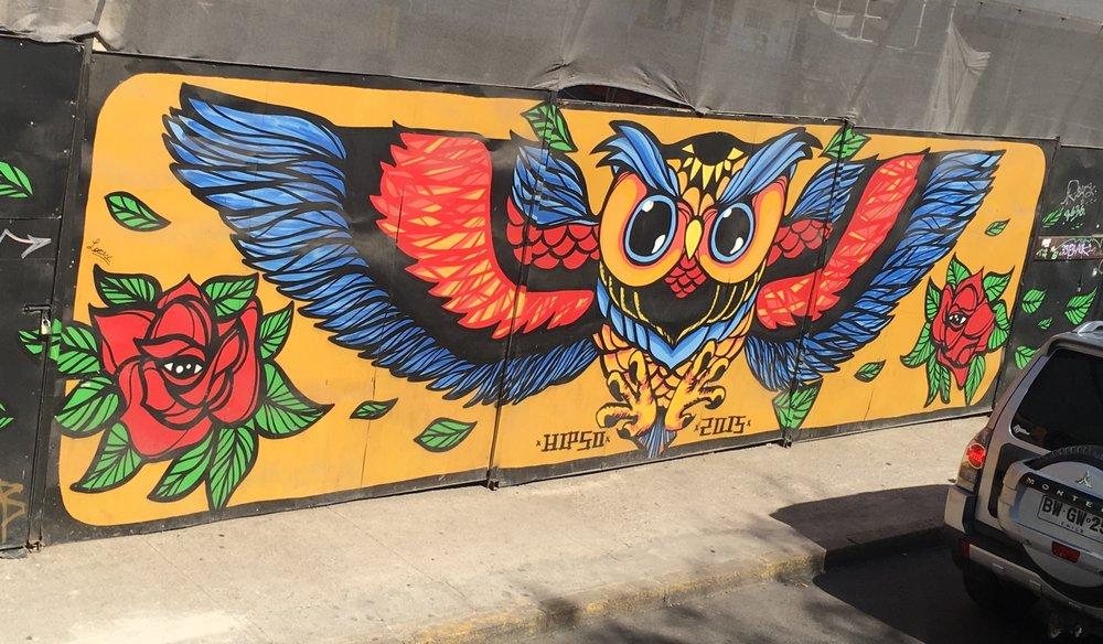 Colourful street art lines a street in Santiago's 'West side.'