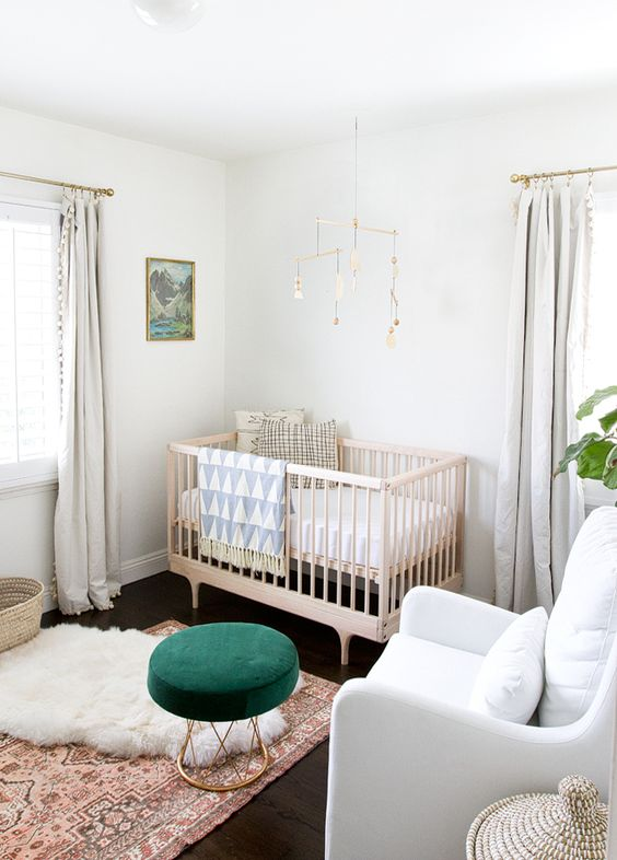 Pale Baby Room with Rich Colour Objects. Rugs, footstools, art