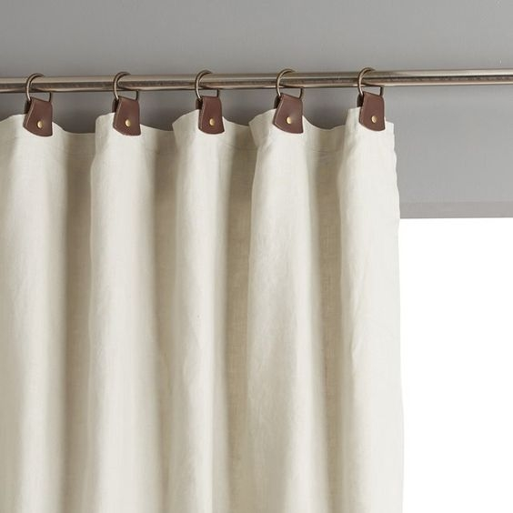 Leather tabs on your natural linen curtains are so fitting with the natural theme and make them a little less girly.