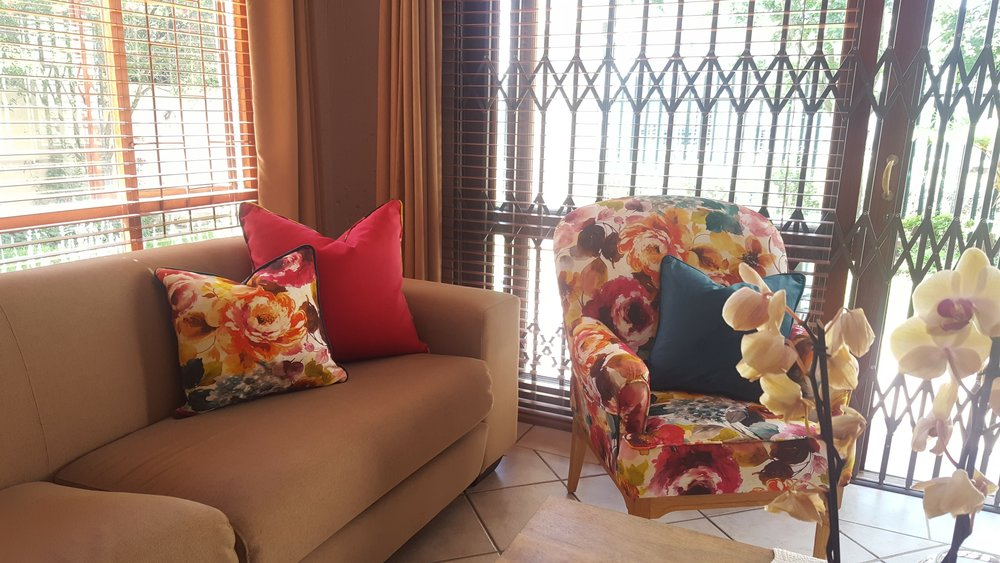 Floral wingback chair recovered