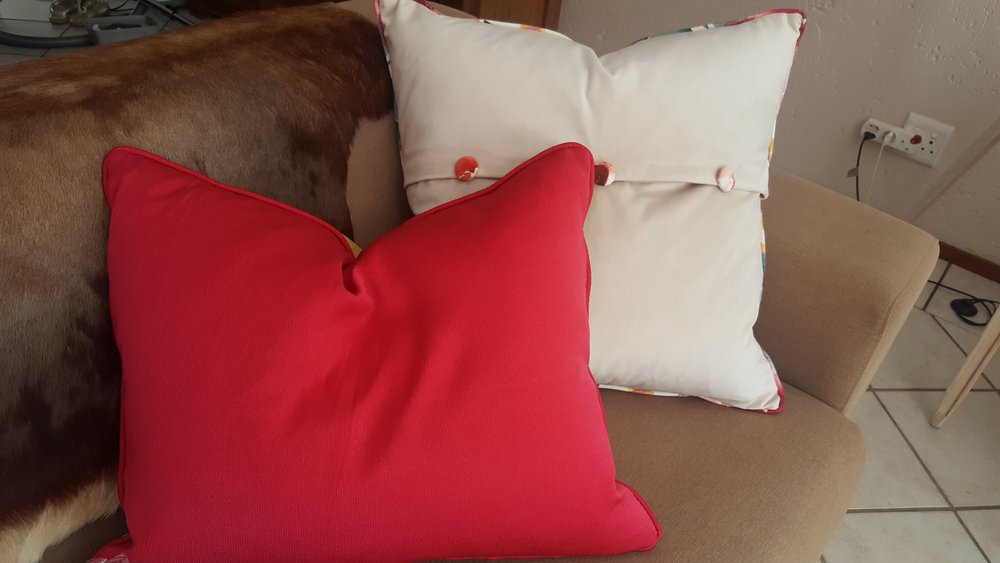 white and pink velvet scatter cushions with floral detail in buttons and contrast piping. Custom made