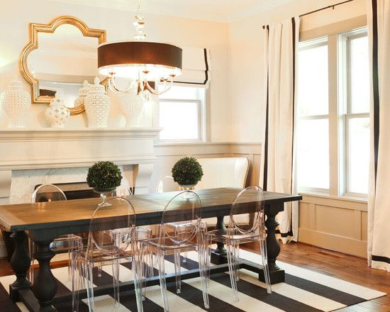 chic striped and gold dining room with plastic ghost chairs