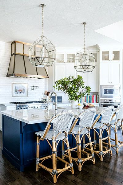woven plastic chairs around the kitchen counter