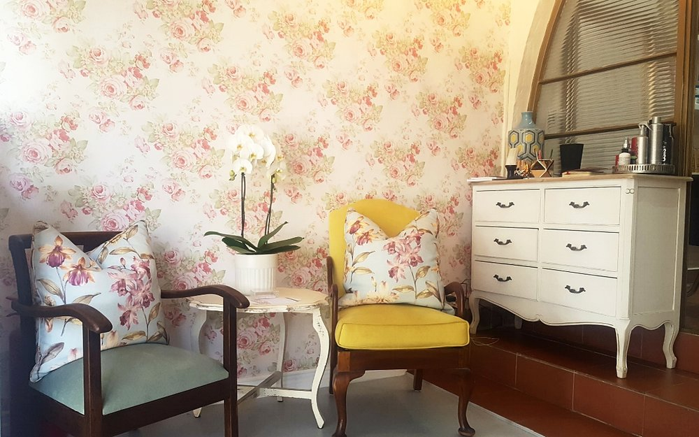 Floral Hair Salon In Johannesburg with matching vintage chairs, and gold trim.